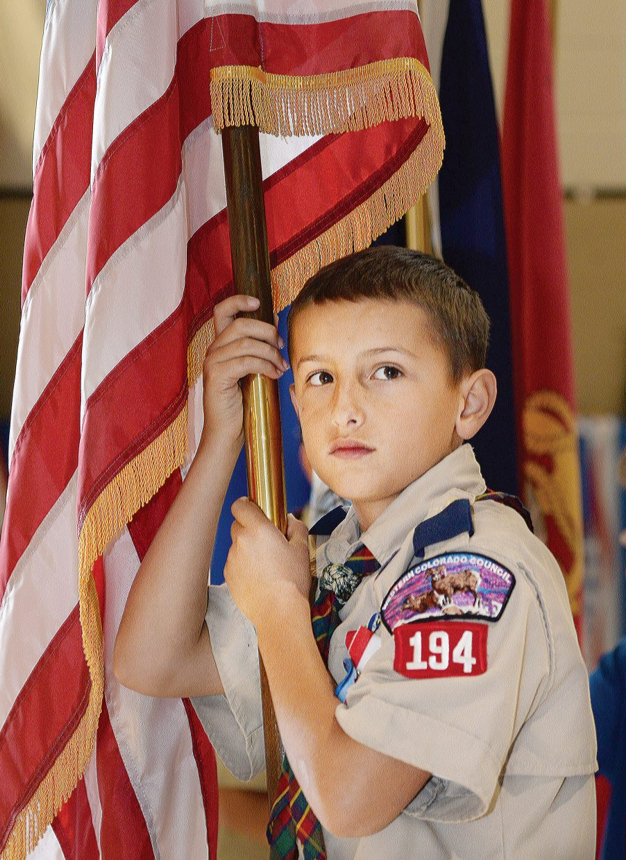 Boy Scout Parker Molina waits to present the flag at the beginning of the fifth-grade class' Veterans Day Program. The students sang songs, read passages and said thanks to the men and women of Routt County who have served in the military.
