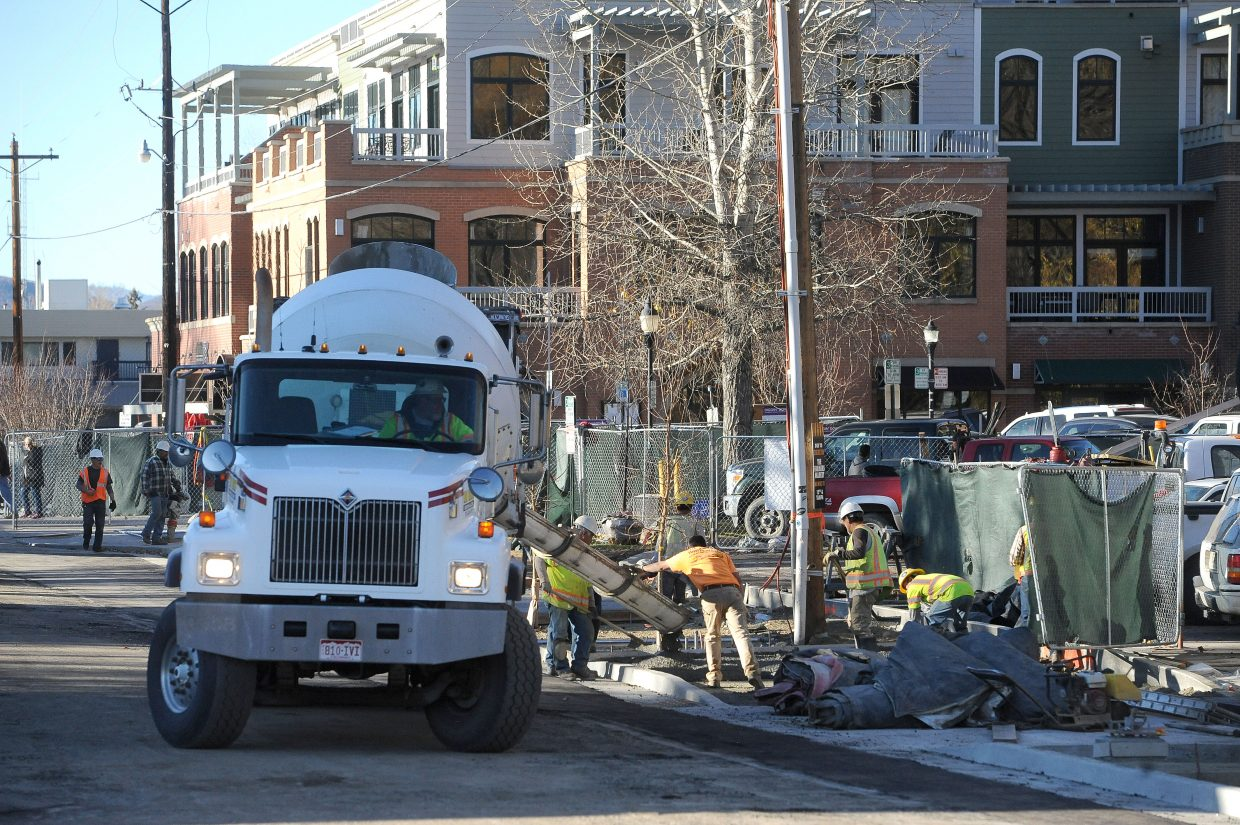 Construction crews pour concrete on Friday as they work to create a new streetscape on Yampa Street.