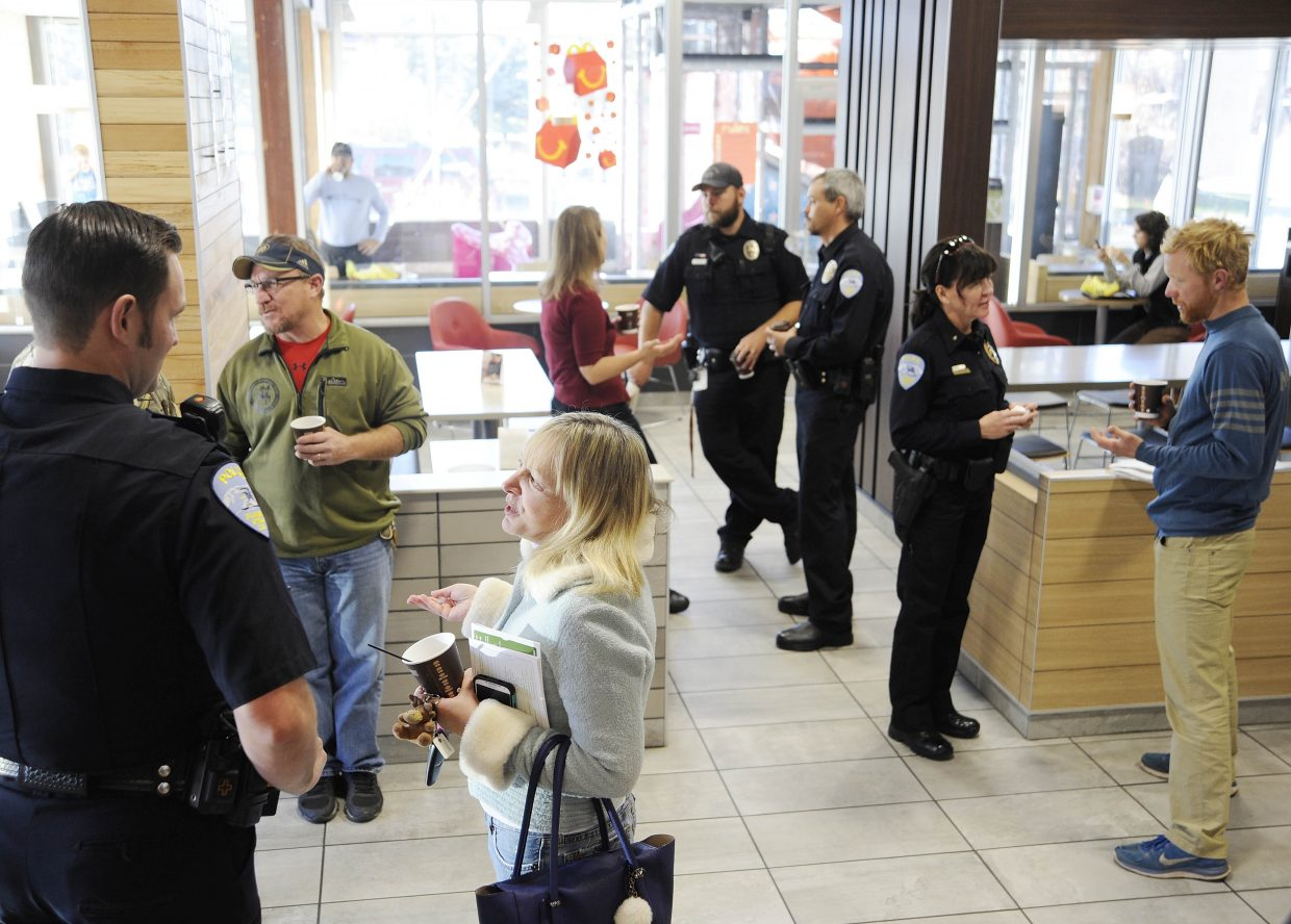 Steamboat Springs Police Department officers visit with residents during their first Coffee With a Cop event Friday at McDonald's. The department plans to host the informal gatherings quarterly.