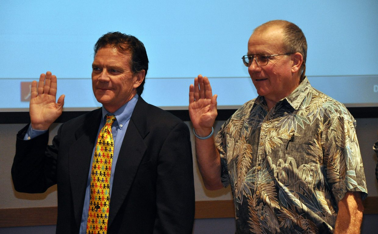 Steamboat Springs City Council members Tony Connell, left and Scott Ford are sworn in 2013.