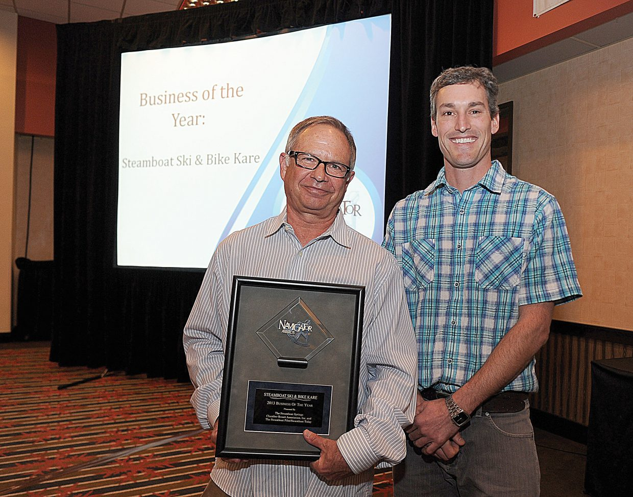 Steamboat Ski & Bike Kare manager Derek Hodson, and co-owner Mike Parra accept the Navigator award for Business of the Year on Tuesday at the Sheraton Steamboat Resort.