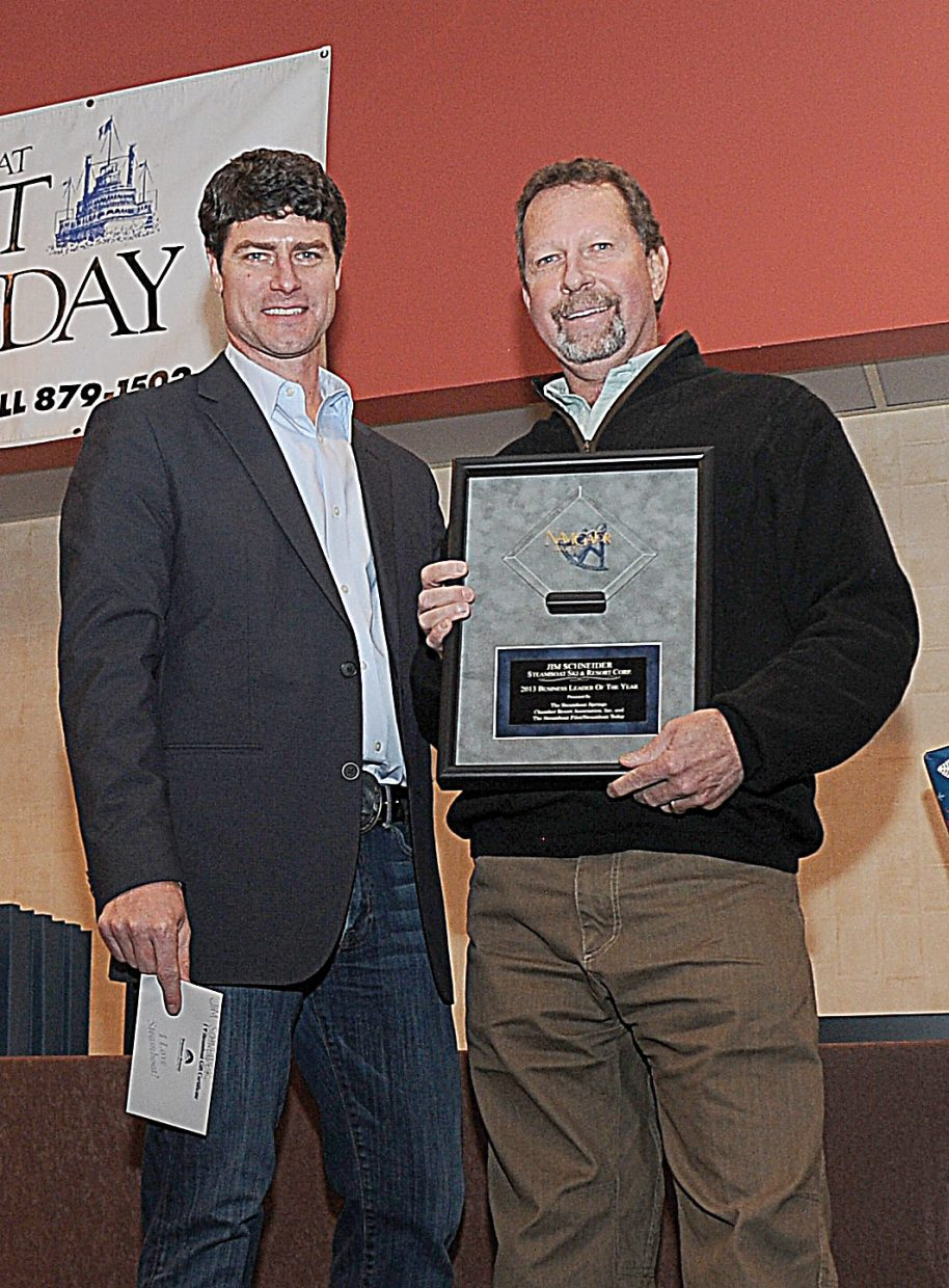 Kerry Shea, the new president of the Steamboat Springs Chamber Resort Association, stands with Jim Schneider, vice president of skier services at Steamboat Ski and Resort Corp. Schneider was named Business Leader of the Year at the Navigator Awards luncheon.