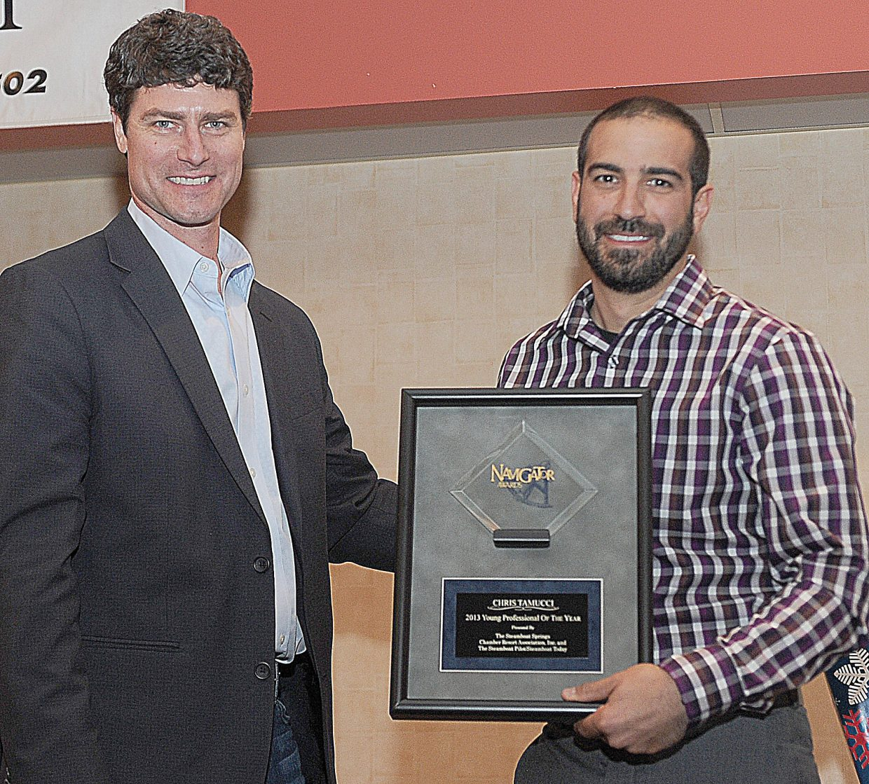 Kerry Shea, the new president of the Steamboat Springs Chamber Resort Association, stands with Chris Tamucci, director of operations for Big Agnes, Honey Stinger and BAP. Tamucci was named Young Professional of the Year at the Navigator Awards luncheon.