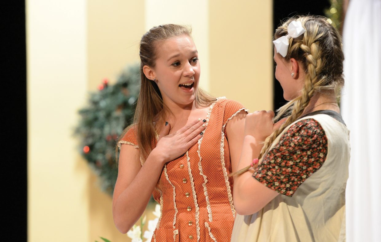 """Anna Winfield plays the part of Grace Farrell while rehearing for Hayden High School's production of """"Annie Jr."""" The school will host performances at 7 p.m. Friday and 2 p.m. Saturday. Tickets are $5 for adults and $3 for students."""