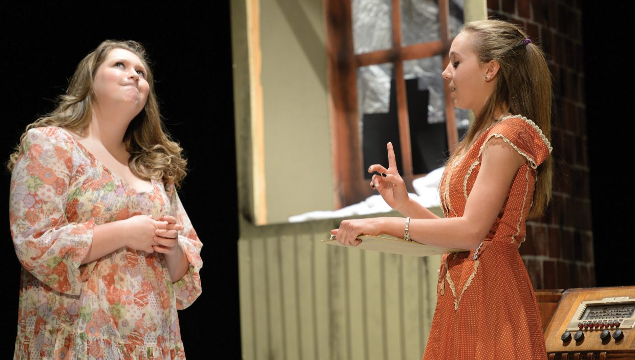 Anna Winfield, playing the part of Grace Farrell (left), and Zoe Hannery, as Miss Hannigan, share a scene while rehearsing for Hayden High School's production of Annie Jr. The school will host performances at 7 p.m. Friday and 2 p.m. Saturday. Tickets are $5 for adults and $3 for students.