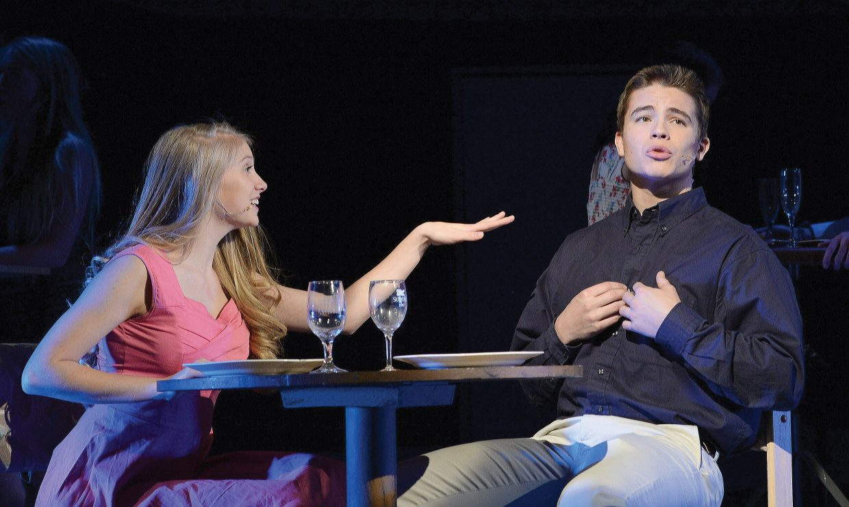 """Keala Fraioli plays the part of Elle while sharing a scene with Charlie Harrington in Steamboat Springs High School's production of """"Legally Blonde."""" The musical will take center stage at 7 p.m. Friday and Saturday at the Steamboat Springs High School auditorium. Tickets can be purchased at All That and at the high school. Students can purchase tickets for $5 with an activity pass. Admission is $12 for adults and $20 for reserve tickets, the latter of which are sold only at the high school."""