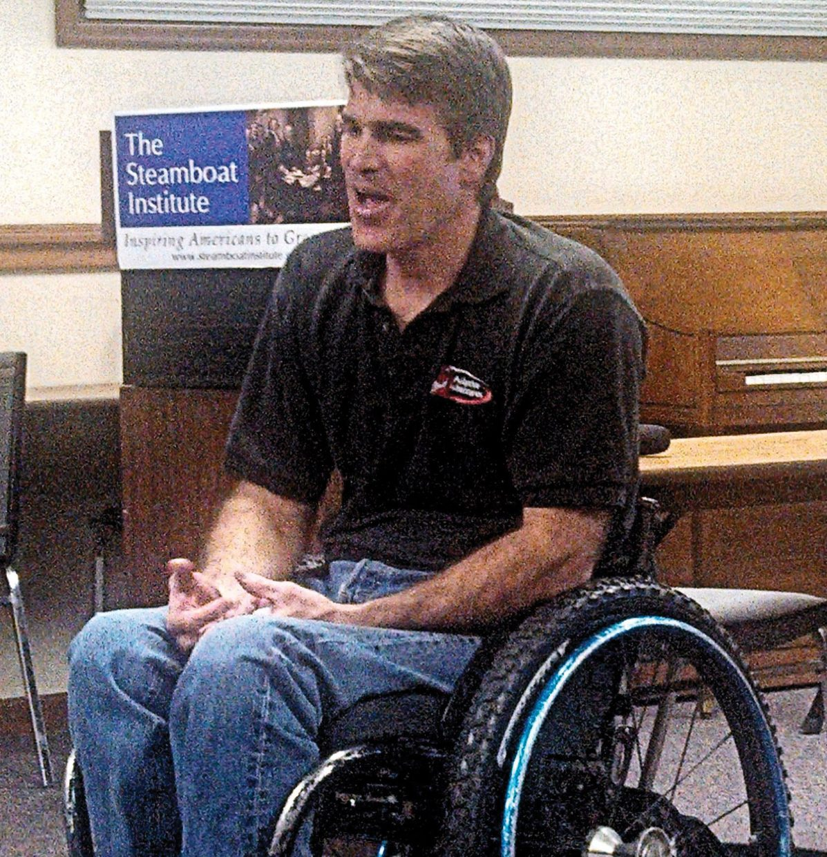 Matt Feeney, co-founder of Adaptive Adventures, talks to The Steamboat Institute's 1773 Club on Tuesday about Adaptive Adventures programs that allow participation in snow and water skiing, bicycling and other outdoor sports by wounded veterans and other people with disabilities.