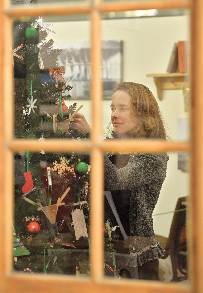 Candice Bannister, the executive director of the Tread of Pioneers Museum, adjusts a decoration on one of the many trees that will be featured in this year's Festival of Trees. The event, which is sponsored by Yampa Valley Bank and Steamboat Ace at the Curve, features 21 trees decorated by local businesses, school groups and other organizations. The trees can be viewed from 11 a.m. to 5 p.m. Saturday through Nov. 24. The event is a fundraiser for the museum.