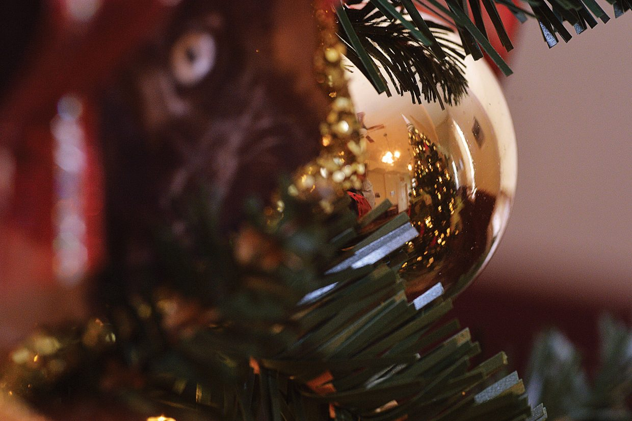 A Christmas tree is reflected in the ornament hanging on another tree at this year's Festival of Trees. The event, which is sponsored by Yampa Valley Bank and Steamboat Ace at the Curve, features 21 trees decorated by local businesses, school groups and other organizations. The trees can be viewed from 11 a.m. to 5 p.m. Saturday through Nov. 24. The event is a fundraiser for the museum.