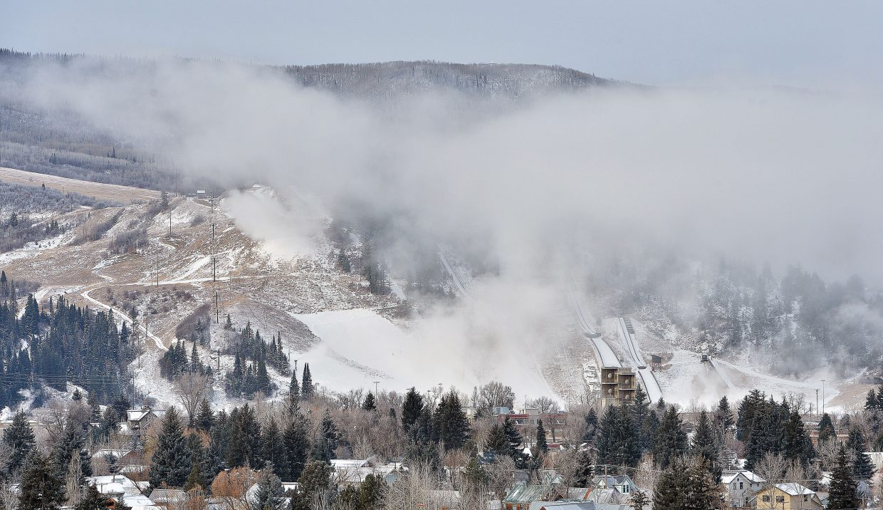 Snow floats above Howelsen Hill Thursday morning as snow guns work to cover the slopes of the ski area. The snowmaking crews got some help from Mother nature later in the day, and are expected to get more help later this week as temperatures are expected to fall,