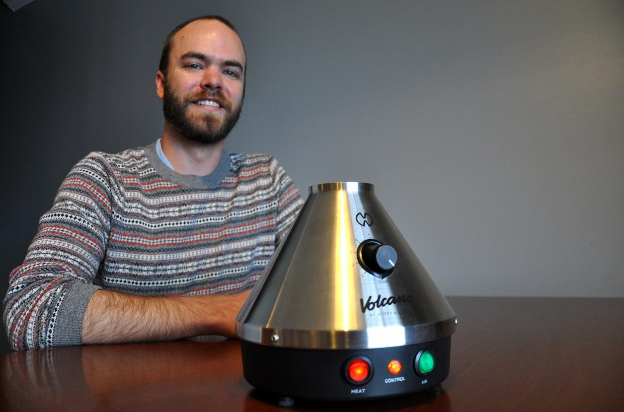 Drew Koehler poses with one of the Volcano vaporizers he is renting out through his company, Steamboat420.