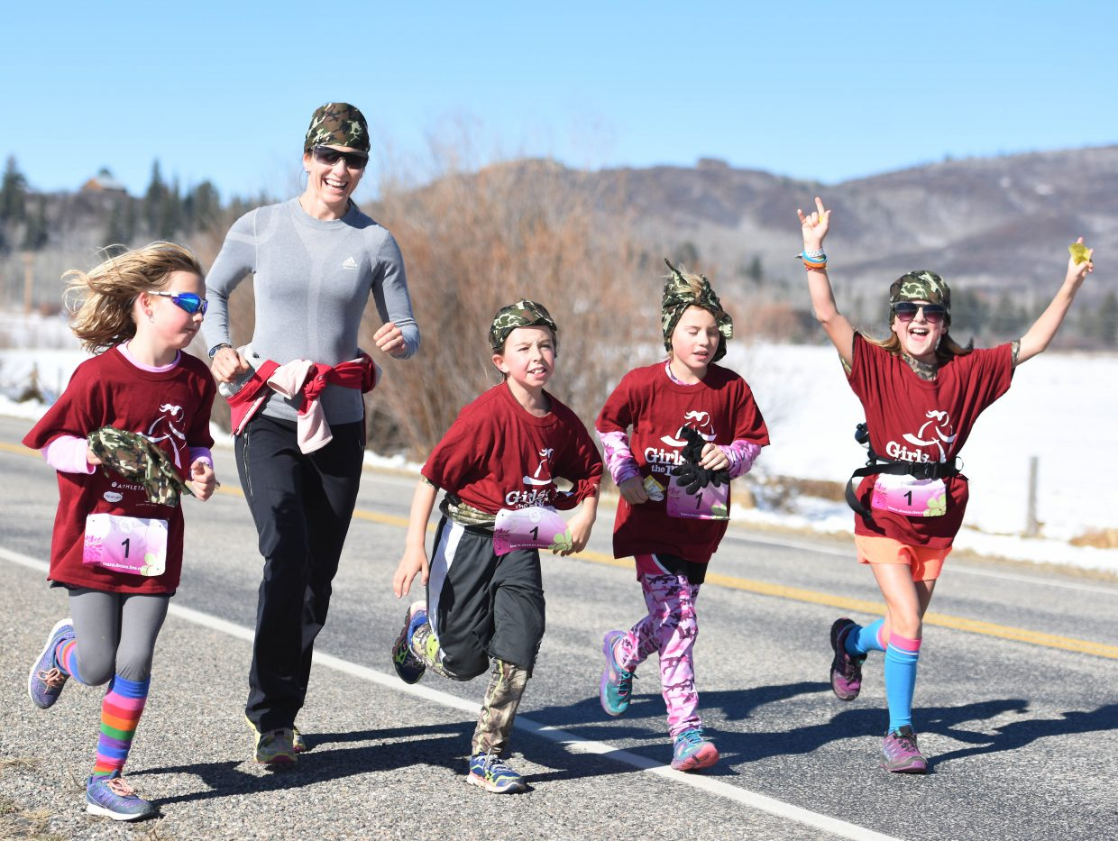 North Routt Charter School students Sydney Lotz, left, coach Summer Owens, Josie Meyring, Ellie Reynolds and Charley Lodwick run Saturday in the annual Girls on the Run 5-kilometer run in Strawberry Park near Steamboat Springs. The event drew more than 600 runners from around the region.