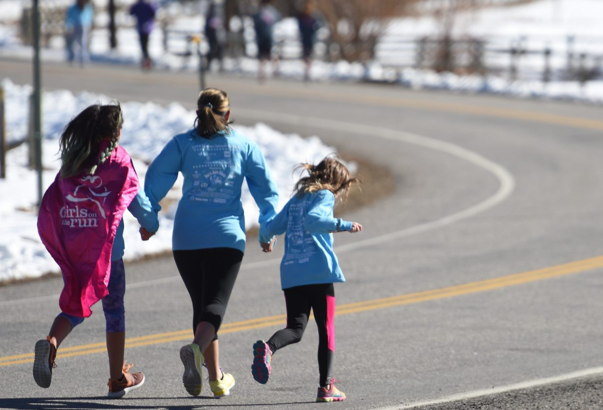 A group of girls runs together Saturday during Girls on the Run.