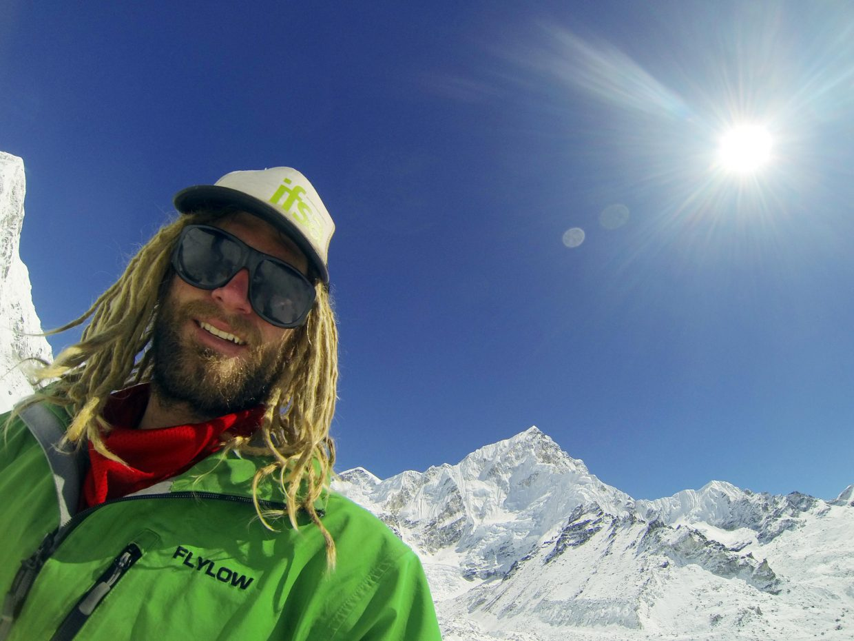 "Kerry Lofy poses in the Himalayans. He said many people he came across on his trip — especially Malaysia — asked to touch his dreadlocks and ""thought I was from another planet."""