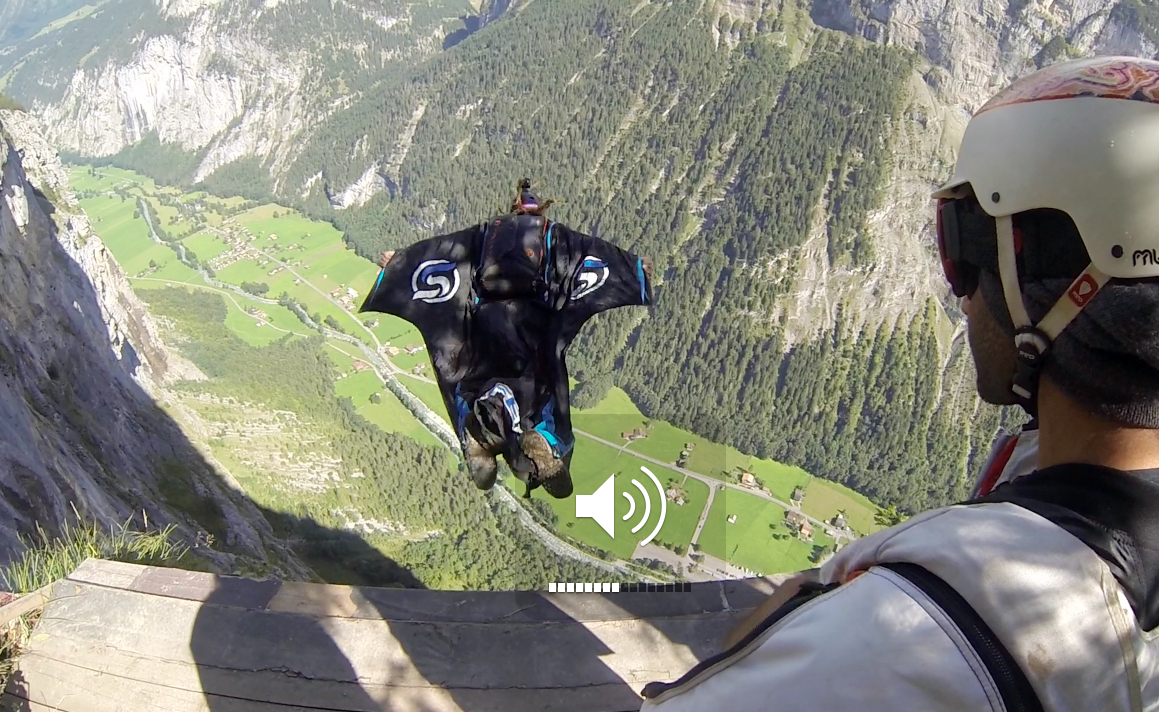A wingsuit BASE jumper takes a leap into a valley in Switzerland.