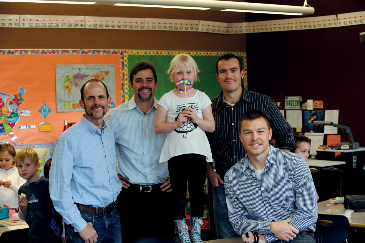 Alpine Bank employees David High, from left, Jeremy Behling, Tom Krabacher and Adam Alspach surround Soda Creek Elementary School second-grader Jorin Peed. The employees are growing mustaches to help the Peed family pay medical bills for Jorin, who has been diagnosed with nephritic syndrome, an autoimmune disorder that causes her immune system attack her kidneys. People can vote for their favorite — or least favorite — mustache at Alpine Bank. The employee with the most money in his jar has to grow his mustache through ski season or match the pot. There is a benefit account in Jorin's name at Alpine Bank. Soda Creek also will host 10-minute fun runs during students' physical education classes from Dec. 2 to 5, and people can pledge money for each lap the students run. For more information about the fun run, email teacher Rebecca Nicholson at rnicholson@ssd.k12.co.us.
