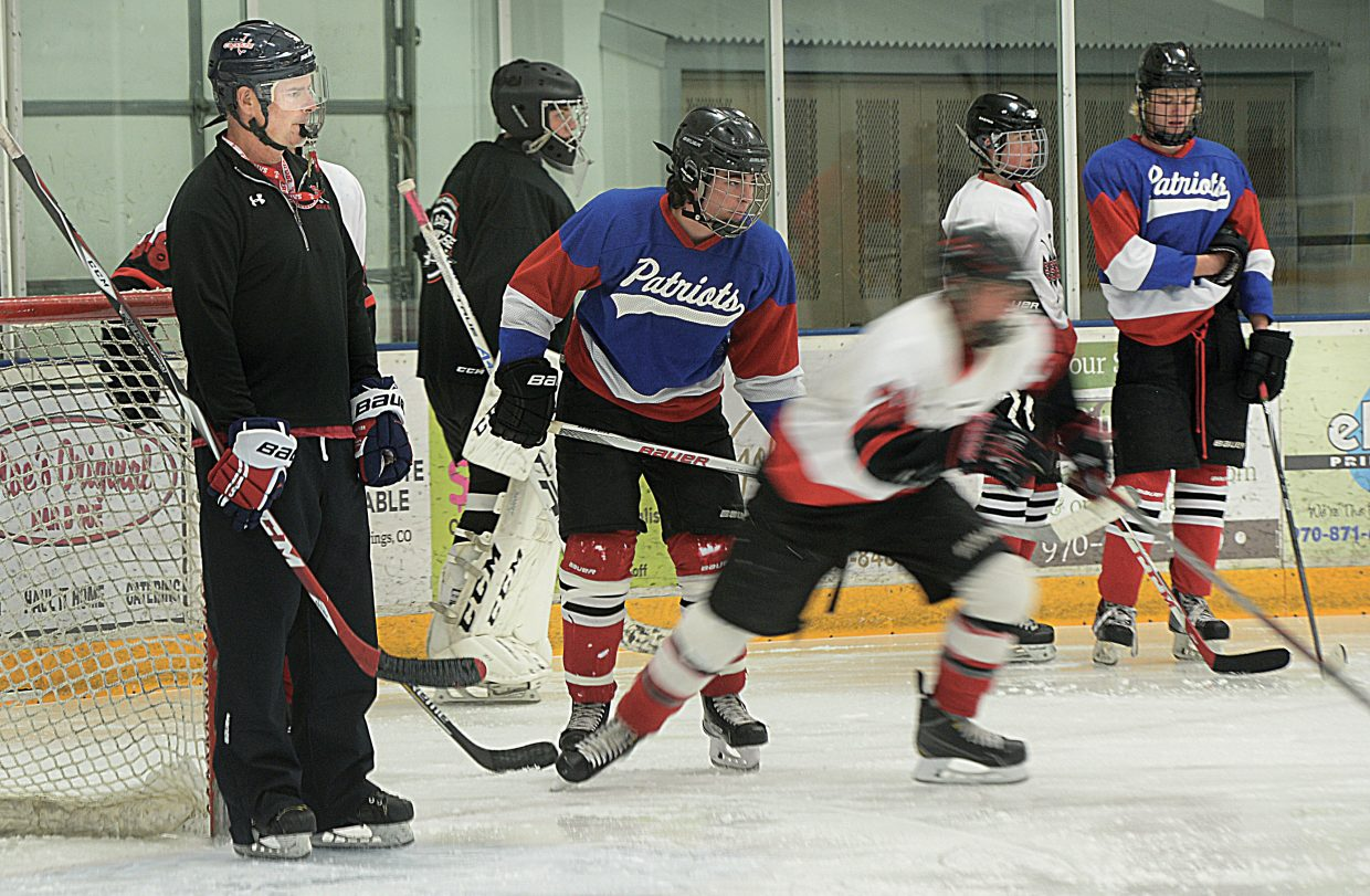 Sailors hockey coach Ernie Thiel runs his players through skating drills during the team's final tryout Tuesday afternoon. Thiel, a longtime Steamboat Springs resident, is entering his first year as the Steamboat Springs High School's head hockey coach.