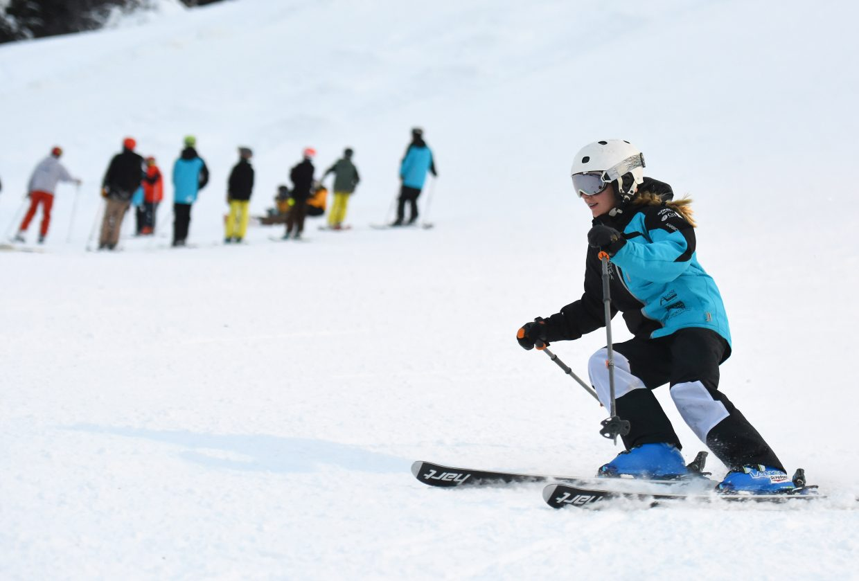 Kenzie Radway flies toward the bottom of Howelsen Hill Tuesday while working with the junior ability freestyle skiing group. It was the first day the Poma lift ran this season, allowing skiers and snowboarders access to about half of the hill's face.