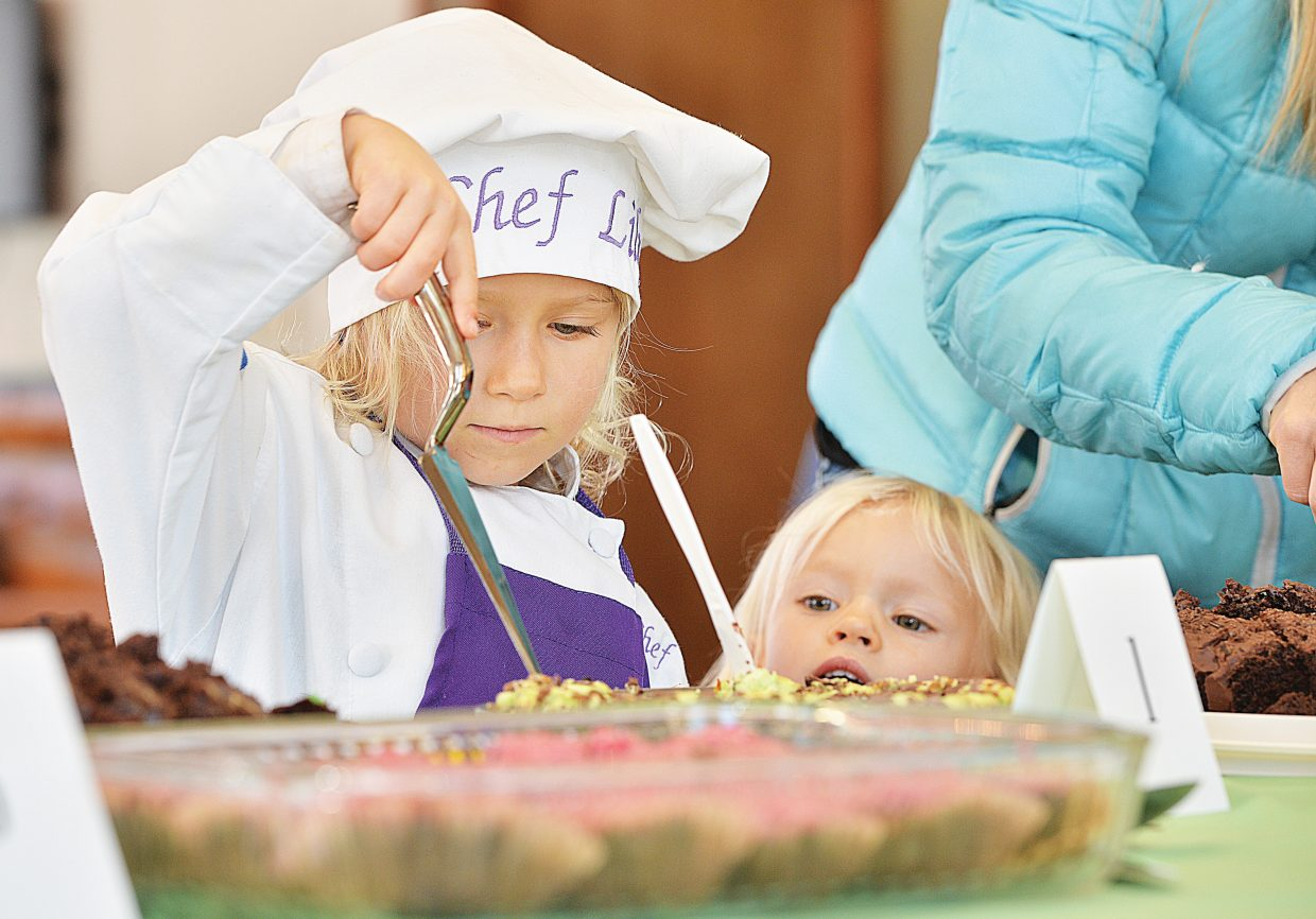 Lily Wingard, 5, and her sister Emma, 2, check out the treats at the 2014 Holiday Dessert Bake-Off sponsored by Steamboat Ace Hardware, the Homesteader, Off the Beaten Path Bookstore and Easy 94.1. The event, which was hosted by the Steamboat Pilot & Today at Olympian Hall, featured tasty desserts created by local bakers. Recipes along with photos of the treats and their creators will be available at ExploreSteamboat.com/bakeoff.