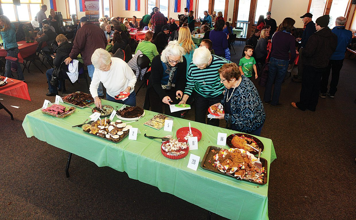 It was a full house in Howelsen's Olympian Hall on Monday during the 2014 Holiday Dessert Bake-Off sponsored by Steamboat Ace Hardware, the Homesteader, Off the Beaten Path Bookstore and Easy 94.1. The event, which was hosted by the Steamboat Pilot & Today at Olympian, featured tasty desserts created by local bakers. Recipes along with photos of the treats and their creators will be available at ExploreSteamboat.com/bakeoff.