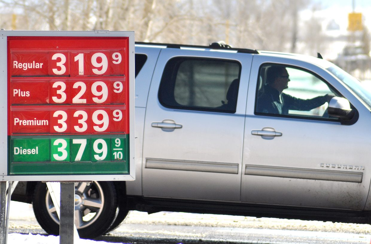 A driver passes a sign showing gas prices at the corner of U.S. Highway 40 and Pine Grove Road on Monday afternoon. The average price for a gallon of unleaded fuel in Steamboat Springs is about 40 cents cheaper than it was on the same day last year.