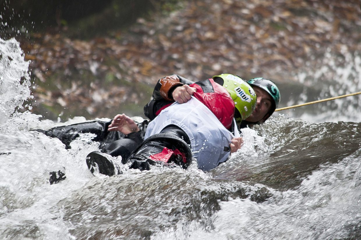 Steamboat Springs' Lucas Strickland hangs on to a boater in the fast-flowing Green River in North Carolina as he's hauled to shore during a competition earlier this month. Strickland leapfrogged a kayak, then caught an injured boater just before some looming rapids. The save was caught on video and has been viewed nearly 500,000 times.