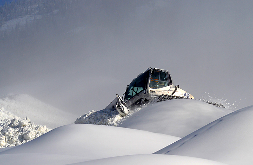 "A snowcat operator breaks up large ""whales"" of manmade snow at Steamboat Ski Area this week after snowmaking crews took advantage of several days of frigid temperatures to prepare for the opening of the ski area Nov. 26. Forecasters say more natural snow could be on the way early next week."
