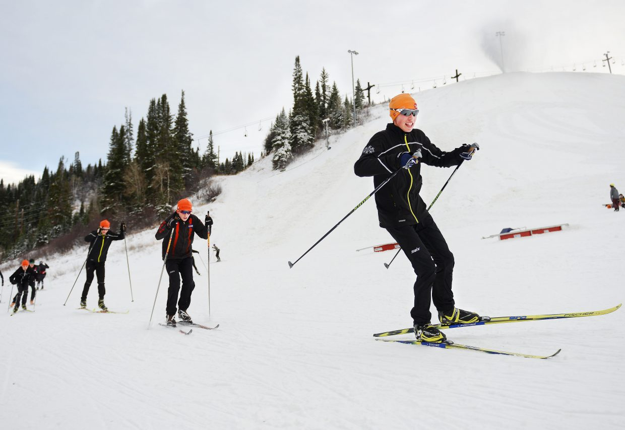 Tyler Terranova leads a pack of skiers near the base of Howelsen Hill on Tuesday as snowboarders practice in the background at the bottom of the hill and snow guns blaze away at the top. Local athletes have logged time on snow by recently skiing on Bruce's Trail on Rabbit Ears Pass, but Tuesday marked their first day of training at Howelsen Hill in downtown Steamboat. It was a busy one, too. Nordic athletes pounded the courses while Alpine athletes worked through one more day of dryland training in the snowpacked fields. Howelsen is expected to open for some Alpine training Wednesday.