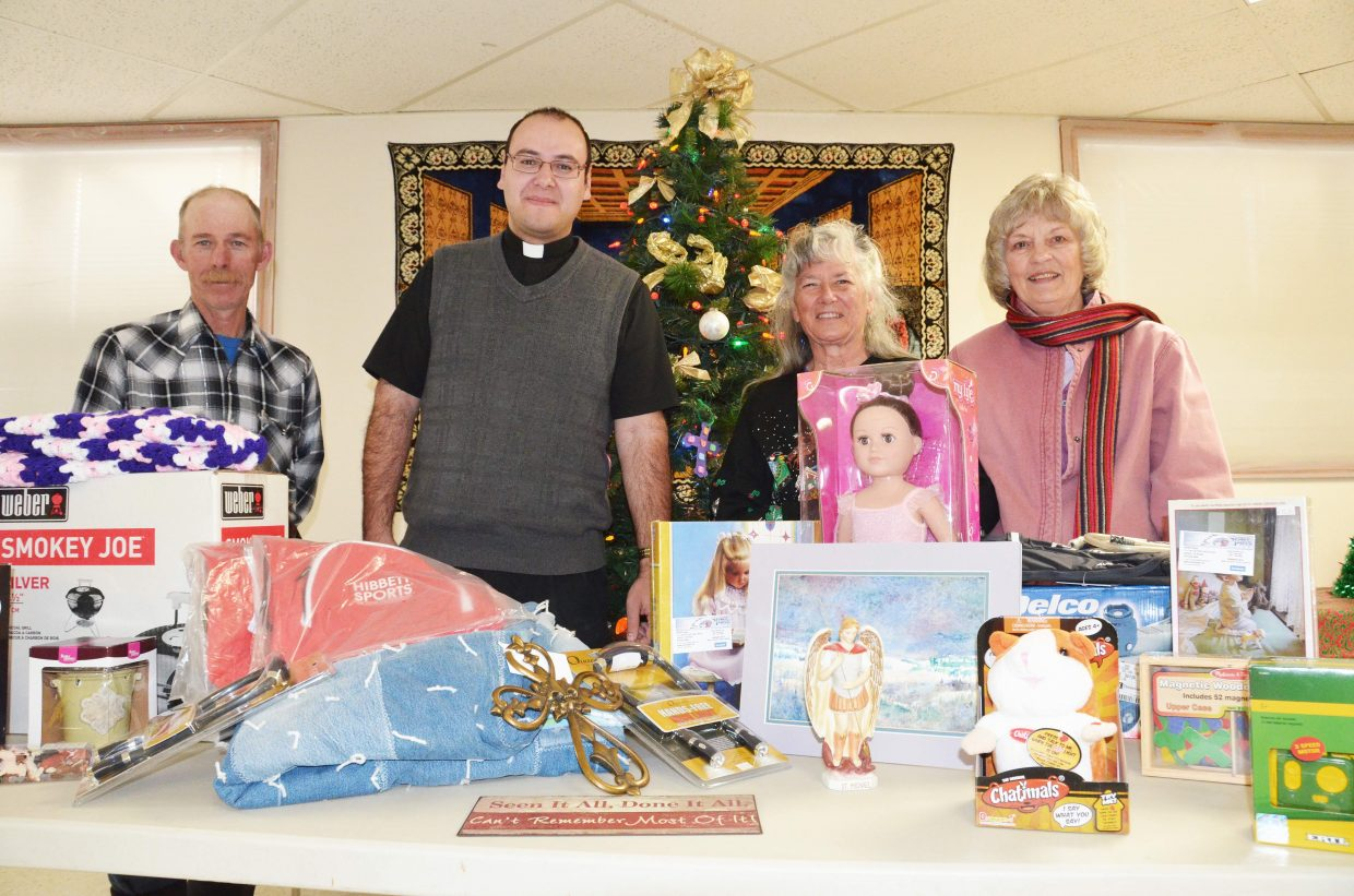 St. Michael's Christmas Bazaar kicks off Saturday. Numerous toys, tools, religious icons and other items will be at the silent auction portion of the Christmas Bazaar. Last year Albert Villard, left, the Rev. Geronimo Gonzalez, Delores Hart and Kathy Janosec gleefully helped with the bazaar. The event starts at 9 a.m. with doughnuts and coffee at St. Michaels. A Mexican lunch will be served 11:30 a.m. to 1 p.m.