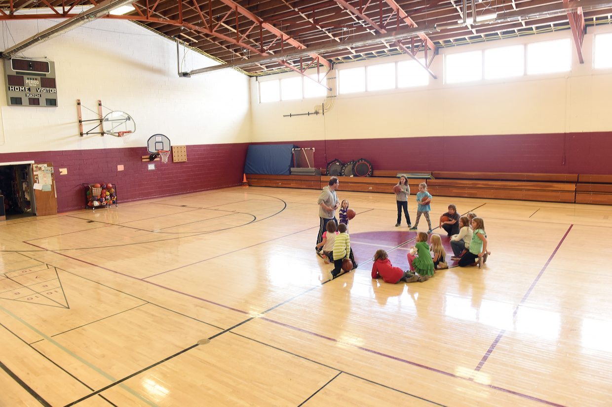 Physical education teacher Artie Weber teaches the basics of basketball inside the South Routt Elementary School gymnasium. Small class sizes mean the students have plenty of room to sharpen their skills.