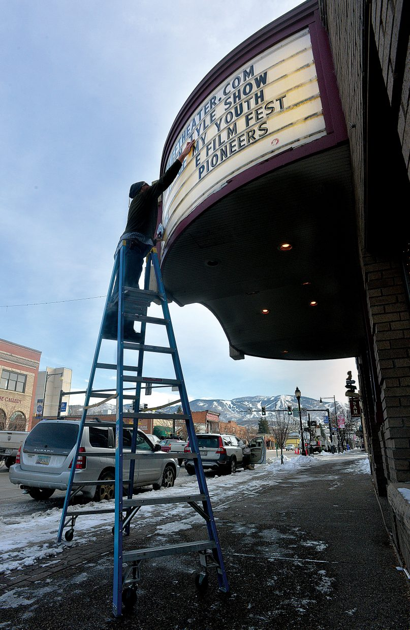 Scott Parker changes the marquee at the Chief Theater in downtown Steamboat Springs on Wednesday morning.