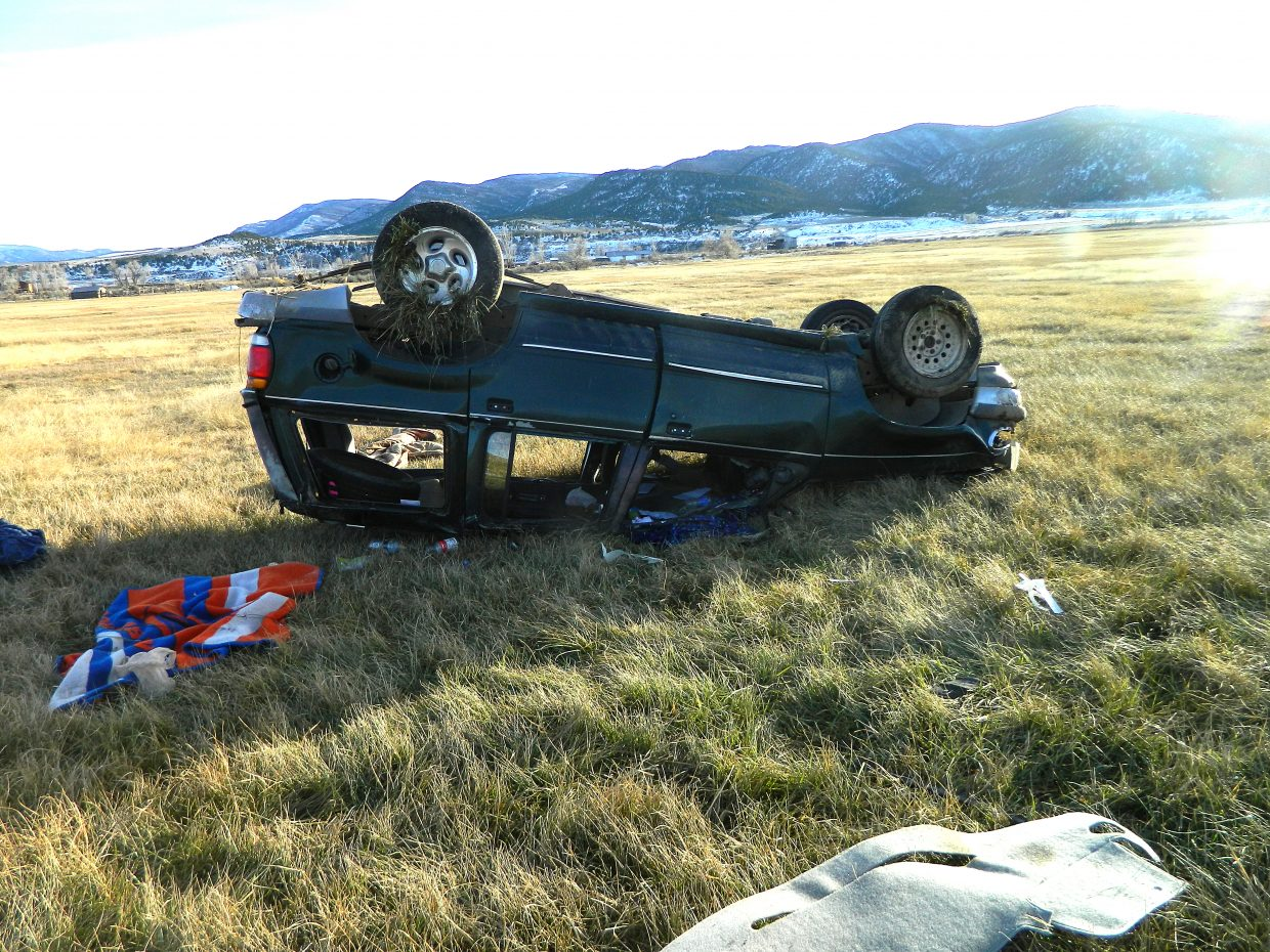 A vehicle landed on its roof after rolling 2 1/2 times off of Colorado Highway 64, roughly 4 1/2 miles away from Meeker.
