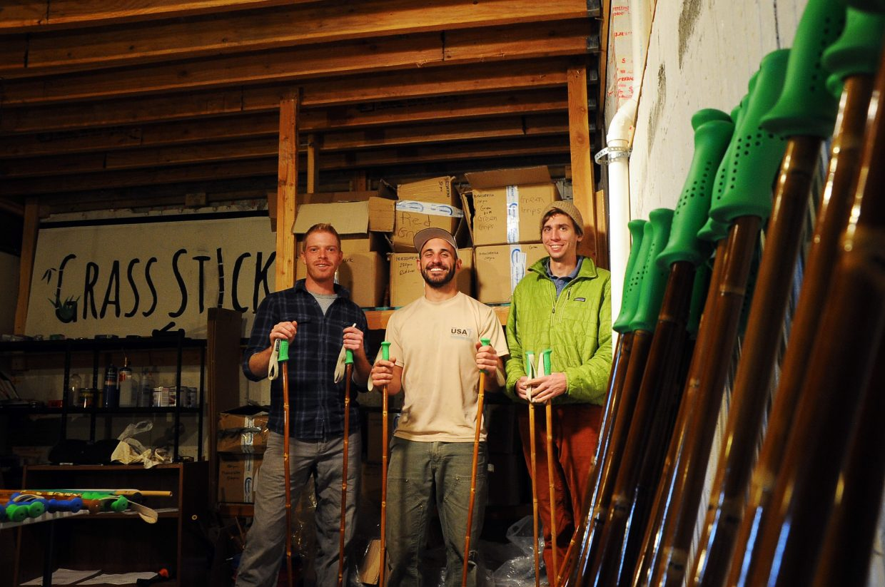 Andrew Bowlin, left, Andrew Beckler, center, and Kevin Dooley are hard at work creating and shipping bamboo ski poles at Grass Sticks.