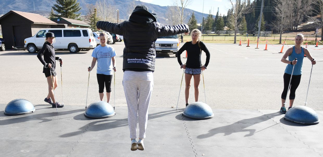 Kate Blamey offers some tips on form Wednesday as her moguls team worked out at Howelsen Hill in Steamboat Springs.