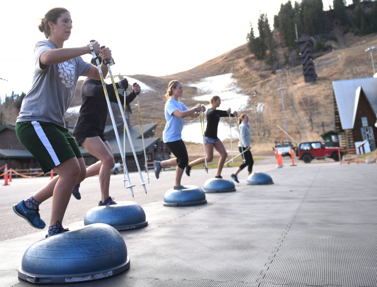 Sophia Schwartz, left, tries to keep her balance on Wednesday at Howelsen Hill while working through a drill focused on helping skiers land after tricks.