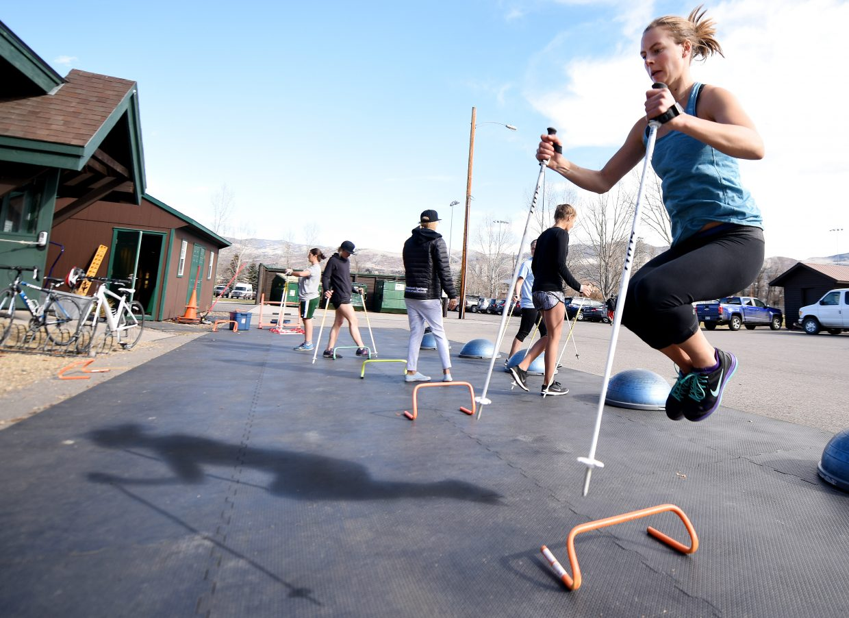 Lane Stoltzner tucks her legs and leaps high while working through a pre-season training session at Howelsen Hill in downtown Steamboat Springs.