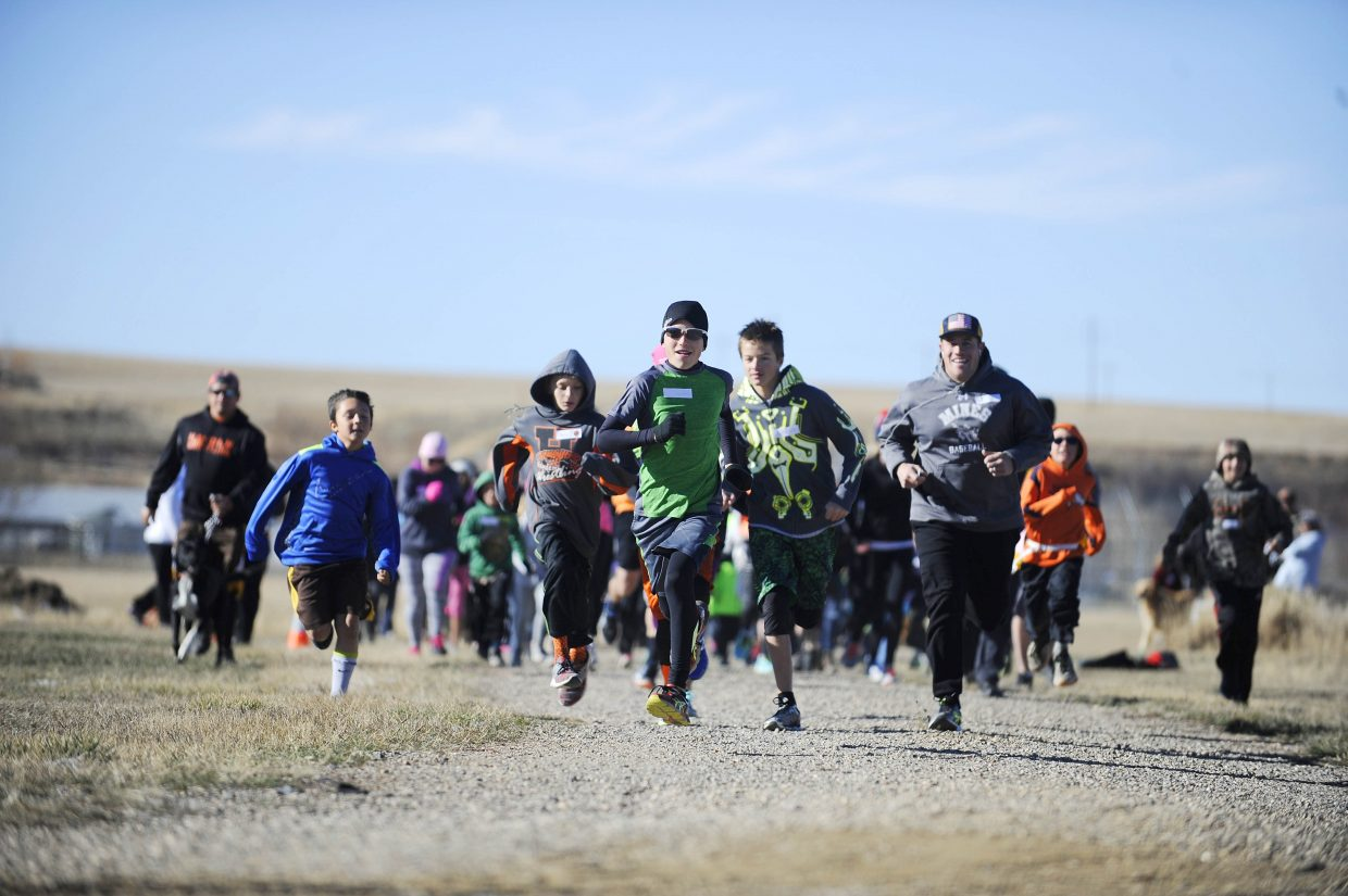 Wyatt Mortenson leads the runners during the Turkey Trot on Saturday at Dry Creek Park in Hayden.