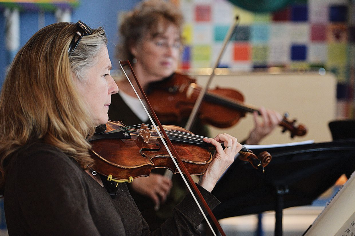 """Teresa Steffen Greenlee, of the Steamboat String Quartet, rehearses for this weekend's """"An Evening with Mozart."""" The show is scheduled for 7 p.m. Friday and Saturday at the Depot Art Center. Tickets are available for $20 in advance at All That, by calling the Steamboat Springs Arts Council at 970-879-9008 or online at www.steamboatarts.org, and they also can be purchased at the door for $30."""