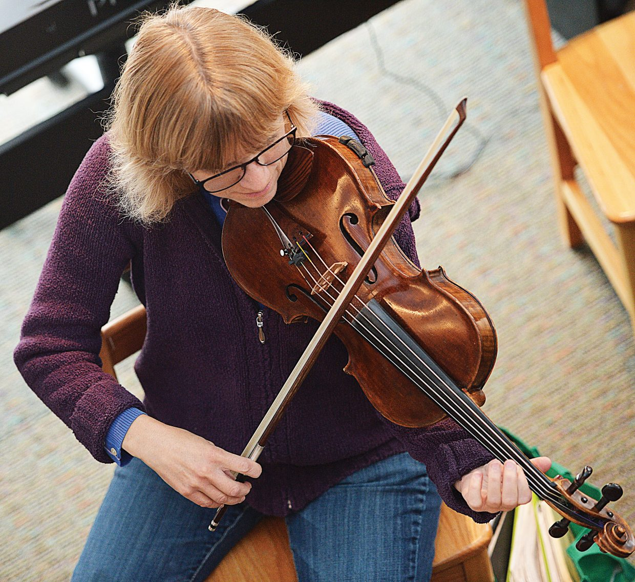 """Mary Anne Fairlie, of the Steamboat String Quartet, rehearses for the Friday and Saturday performances of """"An Evening with Mozart."""""""