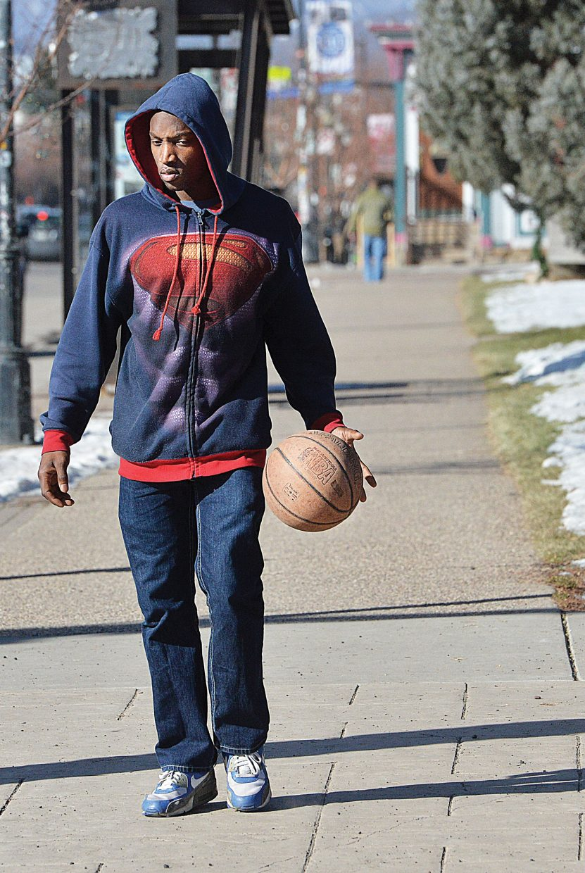 Conrad Real takes advantage of Friday's higher temperatures to dribble his basketball down the sidewalk in downtown Steamboat Springs. Real was in Steamboat Springs playing with a band at the Old Town Pub and was hoping to find a place to shoot some baskets before his next set.