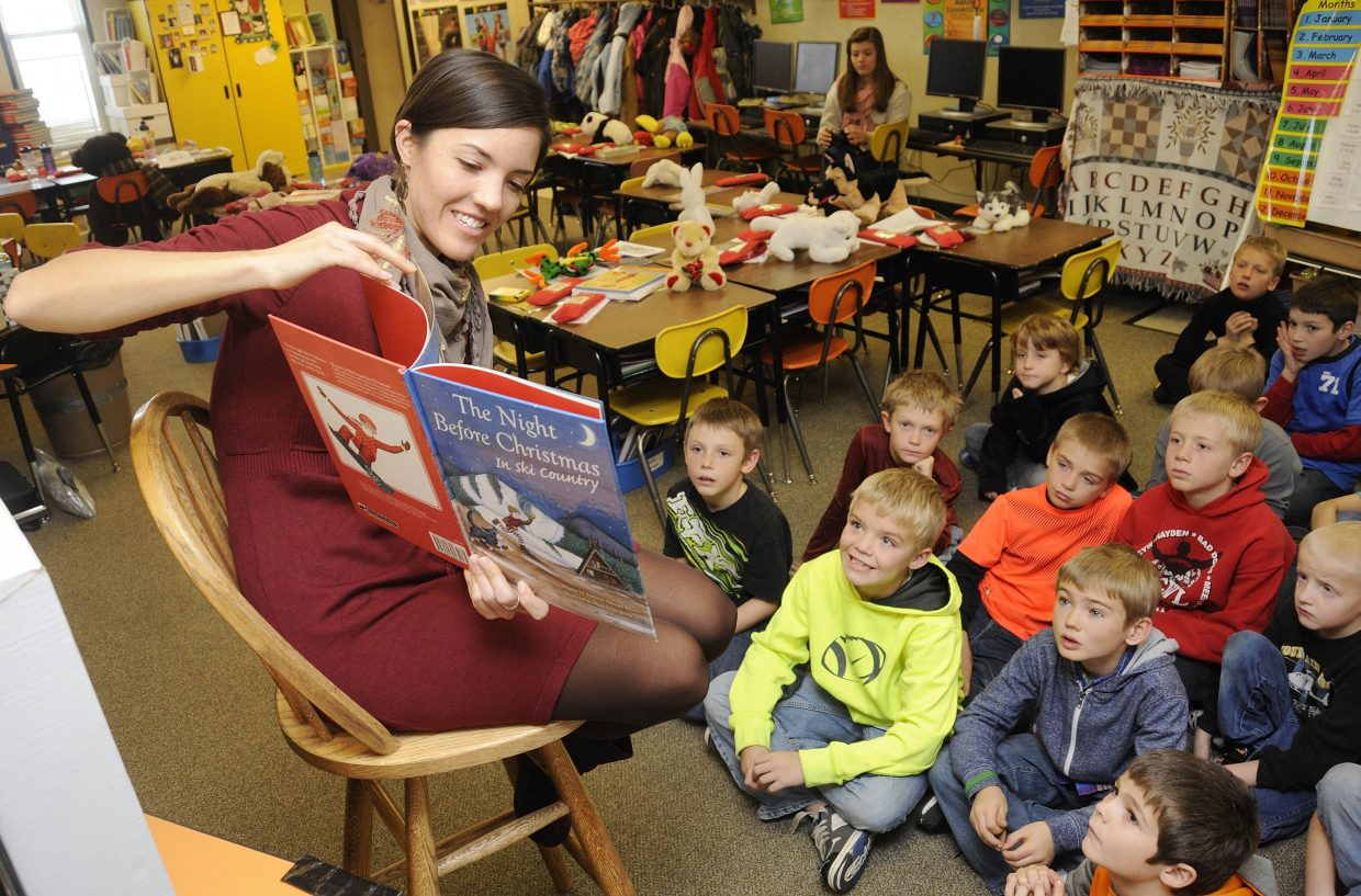 """Hayden native Dana Schlingman reads """"The Night Before Christmas in Ski Country"""" to second- and third-graders Friday at Hayden Valley Elementary School. Schlingman illustrated the book and will have a book signing at 2 p.m. Saturday at Off the Beaten Path Bookstore."""