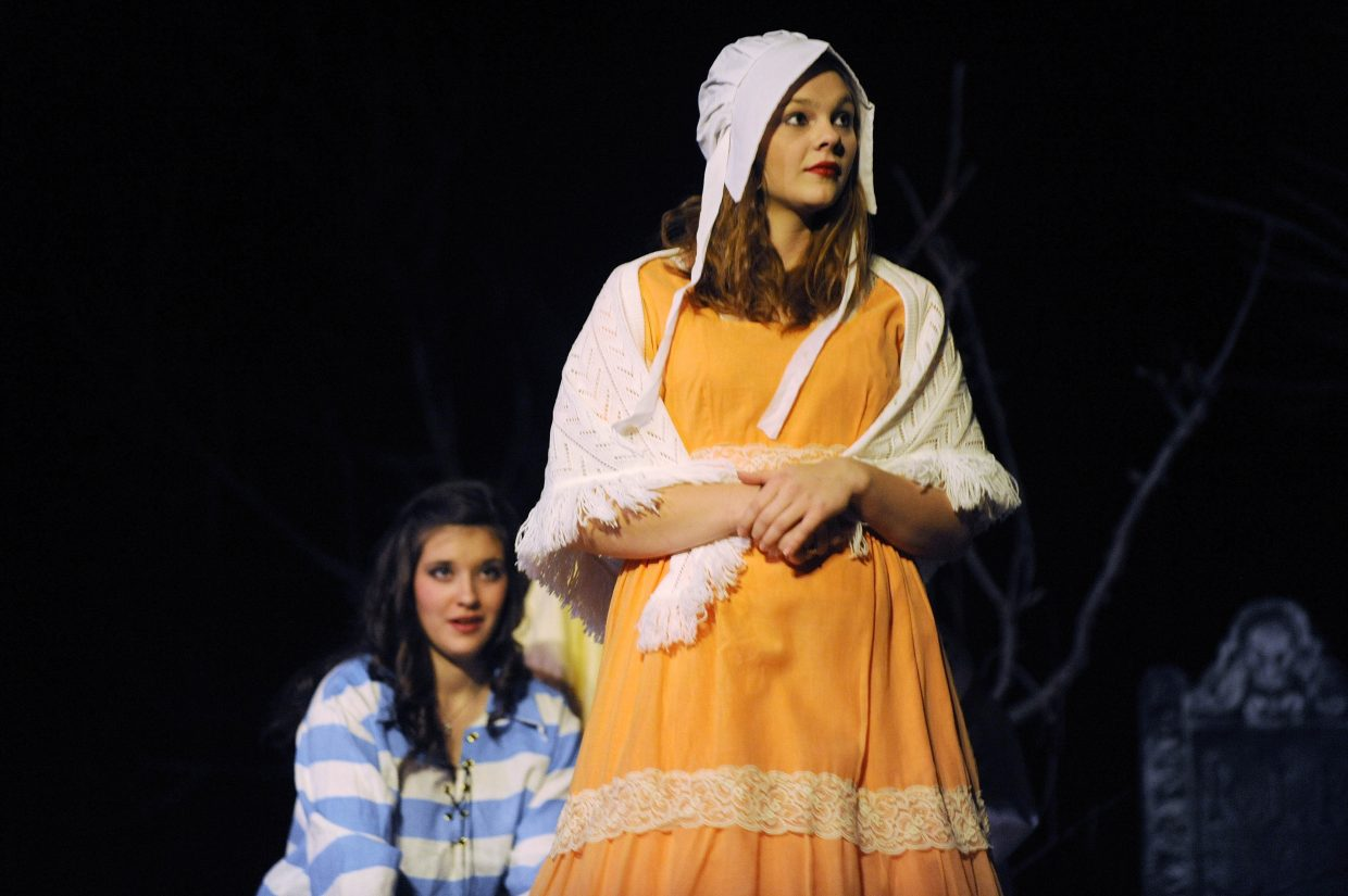 """Kara Cozzens rehearses Friday for the weekend performances of """"The Legend of Sleepy Hollow"""" at Hayden High School."""