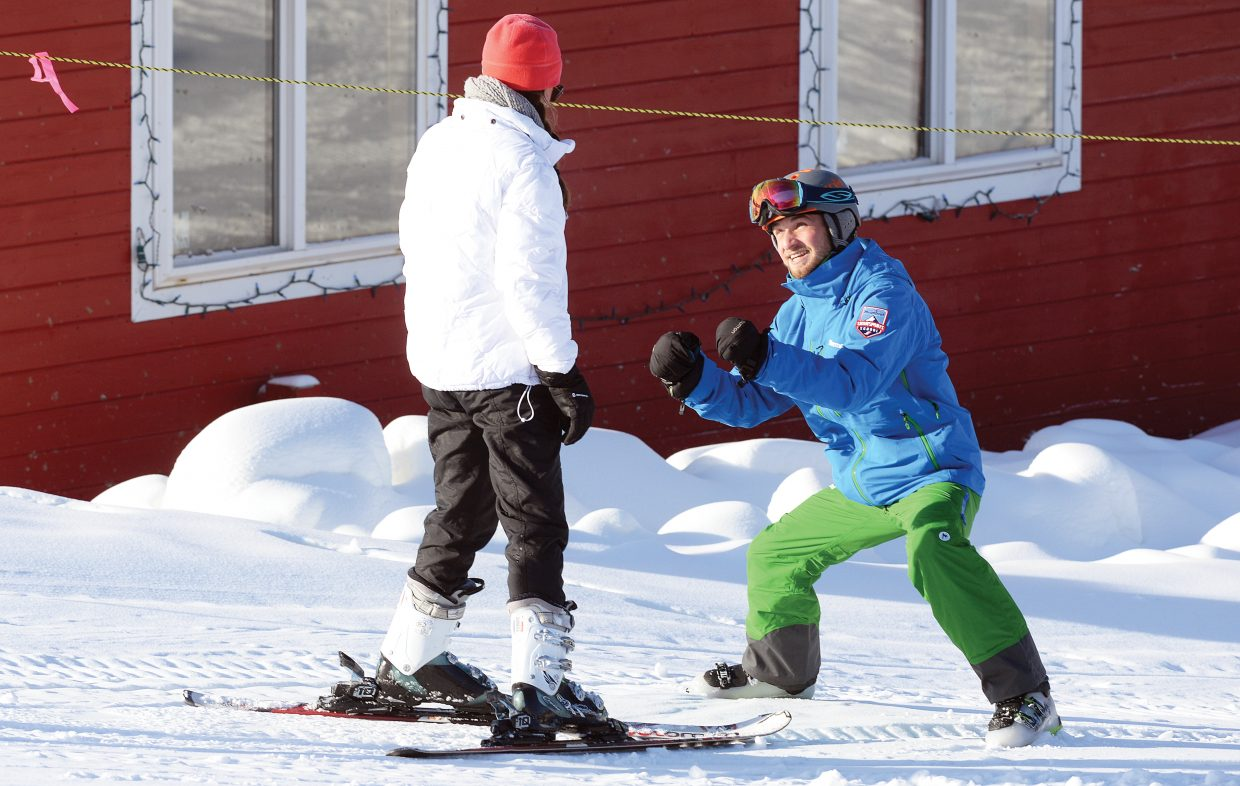Instructor Will Shepherd gives new skier Mary Jordan Drake a few pointers Wednesday on the opening day of the the 2016-17 season at Steamboat Ski Area.