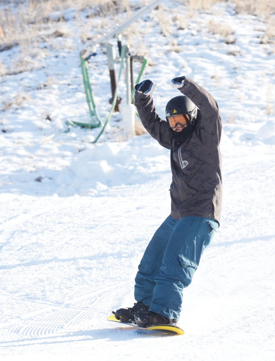 Carlos Maldomado pumps his hands in the air while making his way down the ski run at Steamboat Ski Area during Wednesday's Scholarship Day. The day marked the opening of the ski area for the 2016-17 season with proceeds from ticket sales benefitting the Steamboat Springs Winter Sports Club's scholarship programs.