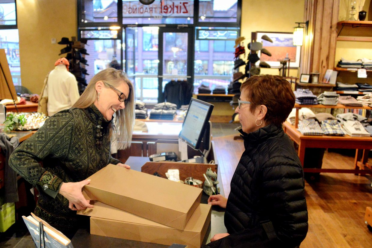 Denise Hitchcock, left, boxes up several purchases for Jane Blackstone on Sunday afternoon at Zirkel Trading in Steamboat Springs. Community leaders are hoping a push to encourage shoppers to stay local can have big impacts on the local economy.