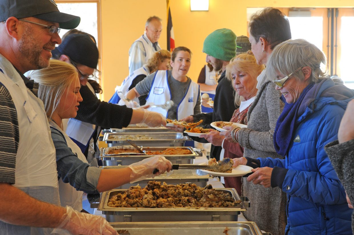 Routt County United Way volunteers serve turkey, stuffing and other food Thursday during the Thanksgiving Community Dinner. The dinner fed hundreds of people in the community.