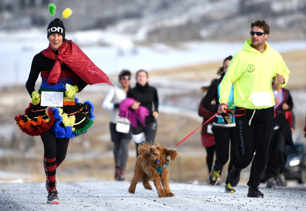 Kris Rowse drew looks from both two- and four-legged competitors Thursday during the annual Turkey Trot 5-kilometer run in Steamboat Springs. The event brought out a record 420 racers, nearly twice the number who took part a year ago.