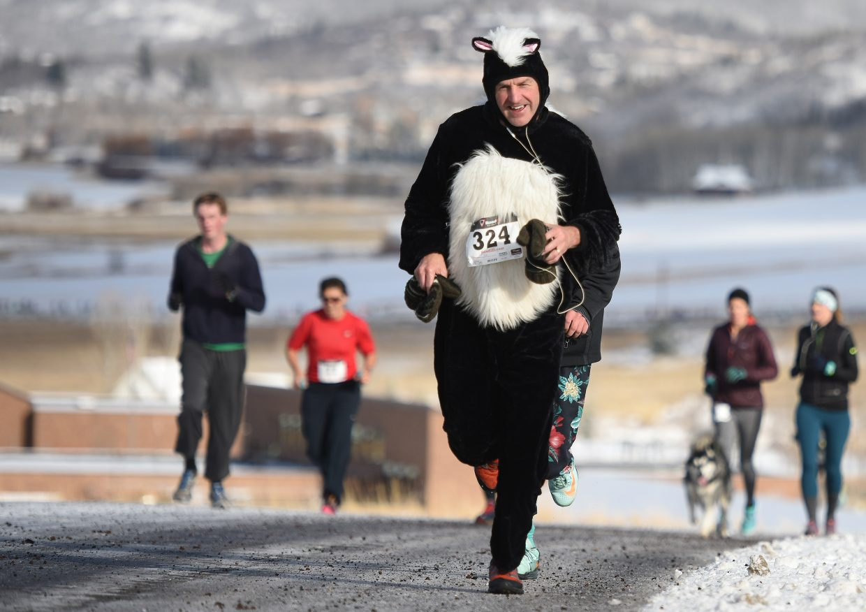 PJ Wharton runs in a skunk costume Thursday during the annual Turkey Trot in Steamboat Springs.