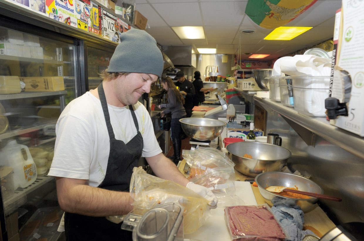 The employees at the T Bar were busy Monday afternoon preparing for a new season at Steamboat Ski Area. Jordan Pike was one of several employees preparing food for Wednesday's Scholarship Day.