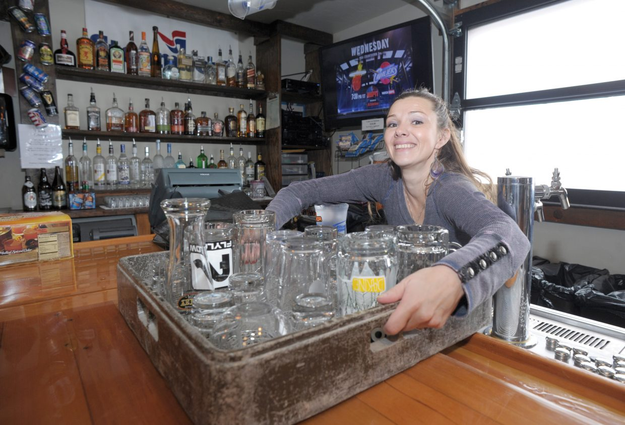 Bartender Turia McKenzie smiles after getting back to work at the T Bar at Steamboat on Monday afternoon. The T Bar will open Wednesday at 11 a.m. for the start of the new season at Steamboat Ski Area.